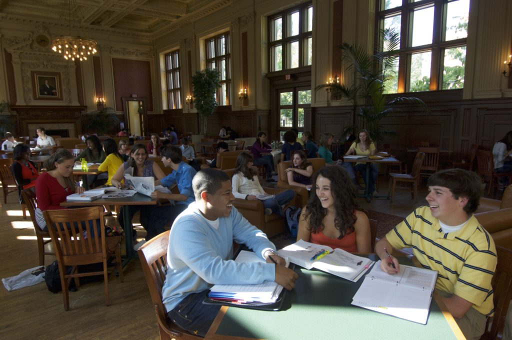 Students laugh in Holmes Lounge