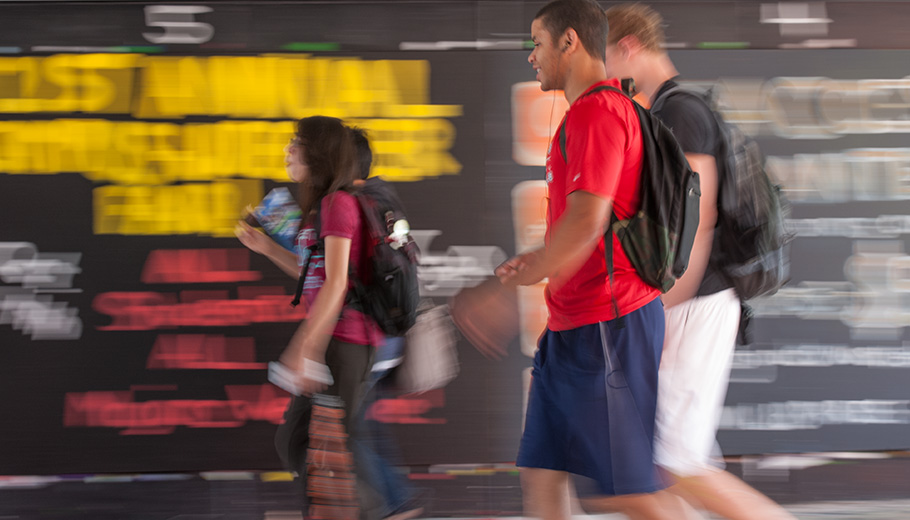 students walking through the underpass