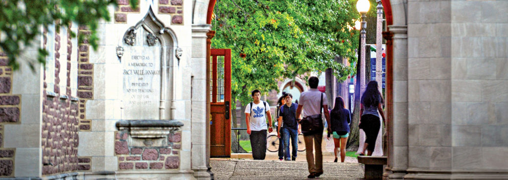 students walking through an archway on Danforth Campus