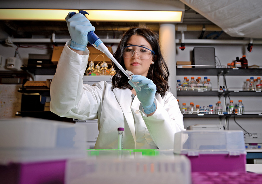 female research student in a lab