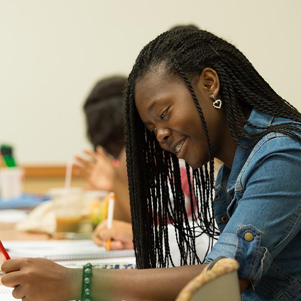 Female high school student writing