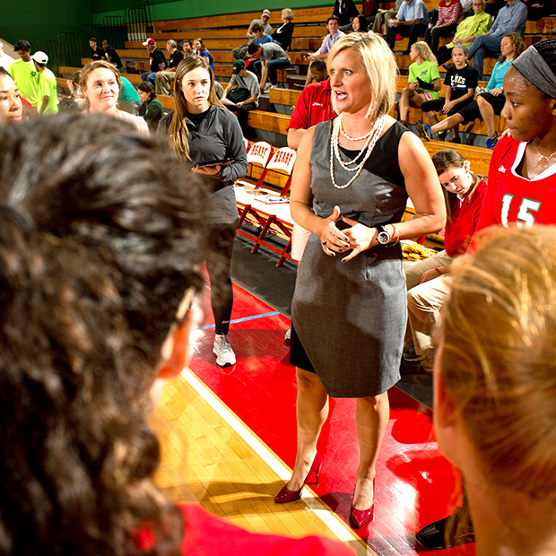 WashU women's volleyball coach and team members