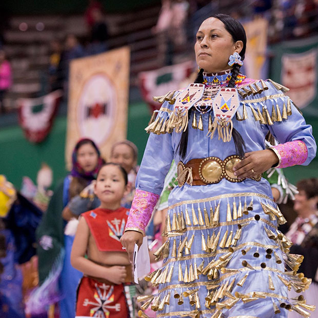 Woman in native dress at Pow Wow