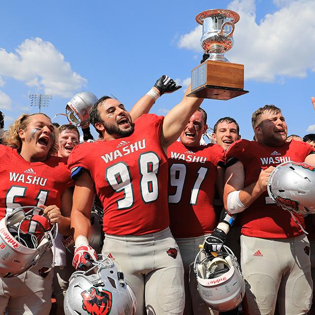Football players raise trophy