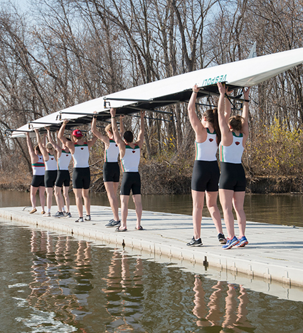WashU Crew members carry their boat