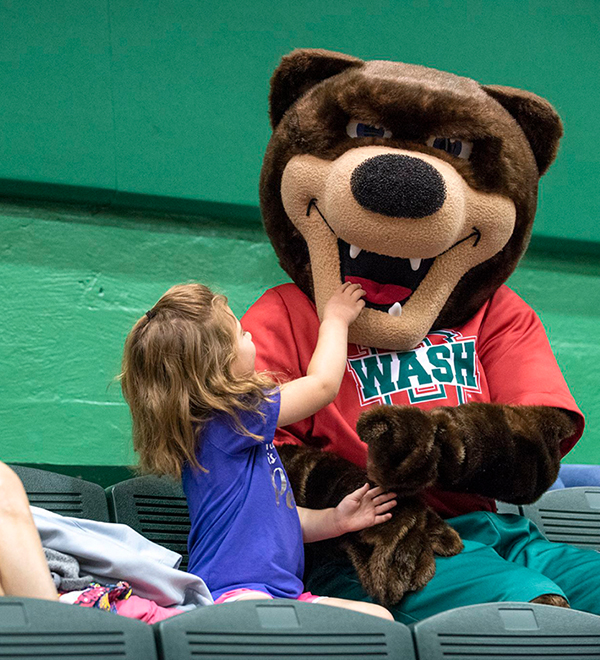 young girl with WashU Bear mascot