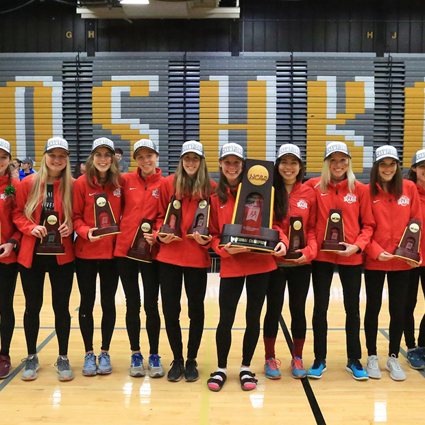Women's Cross Country team with national title trophy