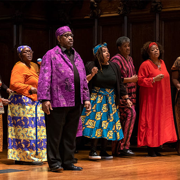 Black performers in colorful dress