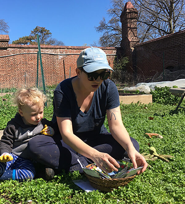 Faculty Fellow Family gardening on campus