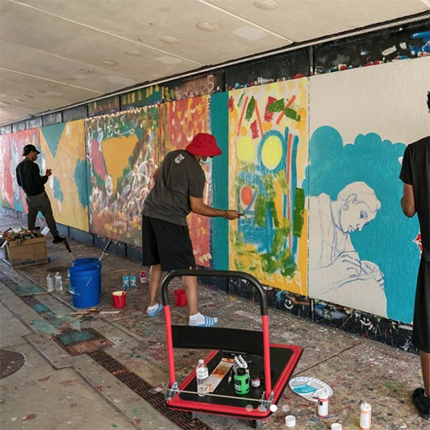 artists painting the South 40 Underpass