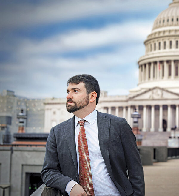 Gabe Rubin in Washington D.C. with the capitol building in the background